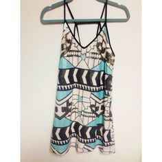sequined dress White, black, gold, turquoise dress with back detail. Only worn once, in perfect condition! Dresses Mini