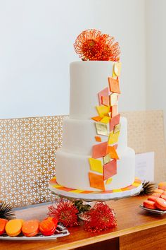Modern aqua and orange wedding cake