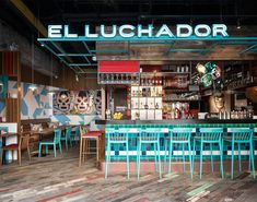 The second installment of the popular mexican restaurant, El Luchador, in Xintandi's new development The House. The compact restaurant centers the action around a brightly tiled industrial bar. Recycled timber flooring, exposed ceiling and industrial deta…