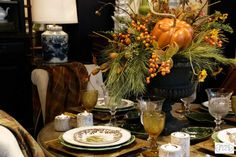 Drape your fall table in the rich colors of autumn. A garden urn makes a perfect vase for a tussle of greens, pumpkins and berries.