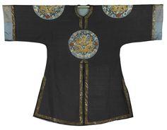 An Imperial dark blue-ground 'dragon roundel' kesi surcoat, gunfu, 19th century.