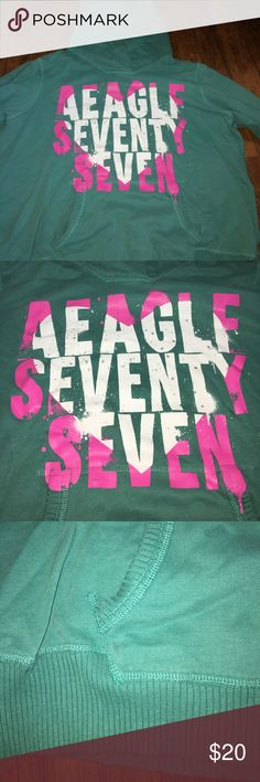 American Eagle green hoodie Size XXL. Is a green hoodie with green and white writing in the shape of a heart with silver splatter paint American Eagle Outfitters Tops Sweatshirts & Hoodies