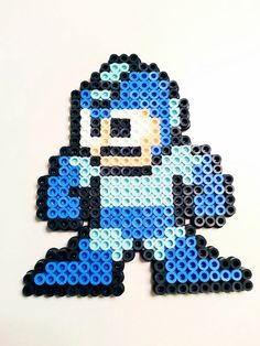 8 Bit Megaman Perler Bead created with fuse beads this project takes 1 sitting to complete.