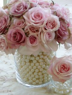 Flowers White Wedding Flowers---LOVE the pearls/beads around the bouquet. For the 'tossing' bouquet, ask your florist to make a small version with shorter stems and white beads. Unique Wedding Centerpieces, Wedding Table Decorations, Candle Centerpieces, Decoration Table, Pearl Centerpiece, Centerpiece Ideas, Quinceanera Centerpieces, Graduation Centerpiece, Girl Baptism Decorations