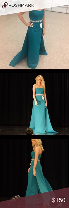 """Teal pageant or prom gown This gown has been worn one time in a preliminary pageant and I won! It's teal with an attached train. It's a column style gown with an attached rhinestone belt and sweetheart neckline. It's around a size 2 my measurements were 34-26.5-36 and I'm 5'6"""" wearing 5.5"""" heels with a tiny bit of room left. It came from Royal We and does not have a designer associated with it. NOT SHERRI HILL Sherri Hill Dresses Prom"""