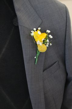 Yellow freesia, billy button and baby's breath buttonhole by Jewel Phon Flowers. www.jewelphonflowers.com.au