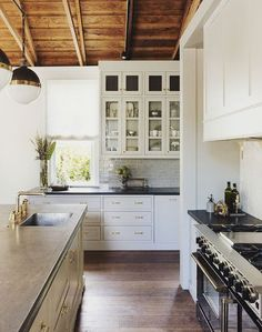 I like the cabinet and range hood style and layout (range opposite sink).  The cabinets look good as hung next to the window.  I also like the window treatment but would prefer a more rustic fabric like unbleached muslin.