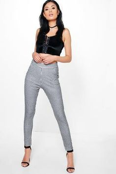 Shop Now - >  https://api.shopstyle.com/action/apiVisitRetailer?id=602765979&pid=uid6996-25233114-59 boohoo Catarina Monochrome Gingham Skinny Trousers  ...