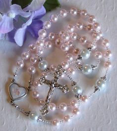 Beautiful pink rosary, similar to one given to me as a child by my grandmother.  Unfortunately I tried to shine mine a year ago and the solution removed the beautiful pink coating on beads.