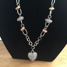 Very unique crystal heart in Silvertone Rhodium This is an attention grabber.  The chain is similar to the rolo design.  Than on the chain you have a larger loop with a small gold tone circle none rose tone n a bigger silver one with crystals.  One of a kind. Park Lane Jewelry Necklaces