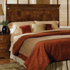 Bring stately style to your master suite or guest room with this handsome wood headboard, showcasing a checkered design and carved details.     ...