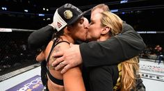 Out UFC champ Amanda Nunes shares victory kiss with partner after defending title