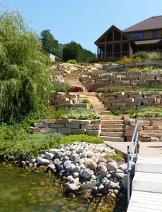 outcropping steps, retaining walls, hillside planting, lakeside planting
