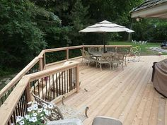 Wood Deck with metal railing and large outdoor eating space. www.milesbradley.com