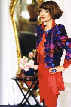 Loulou de la Falaise wearing a pair of her tasseled earrings and a 1990 Yves Saint Laurent haute couture jacket.  Photo by Oberto Gili.  Vogue Germany, September 1990.