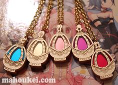 """Puella Magi Madoka Magica inspired """"Soul Gem"""" laser cut acrylic charm. Using images from the animation and artbook, I transformed the Soul Gem into an elegant shimmering gold and mirror acrylic necklace which you can wear with daily outfits for a little touch of Mahou Shoujo elegance.    The Soul..."""