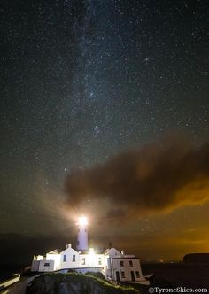 Beautiful Fanad lighthouse under a sea of stars