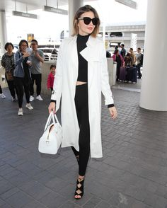 eb7c26ed4c ... Secret model Miranda Kerr was spotted departing from LAX airport in Los  Angeles