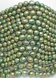 Detailed shot of our #Green #Baroque #Freshwater #Pearls. These have a great #luster with a really organic look. #BaroquePearls #FreshwaterPearls #Pearls #GemStones #JewelryMaking #DIY #JewelryDesign  #Necklace #Bracelets #Gems  #Beads #Gempacked #BellaFindings