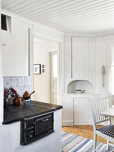 my scandinavian home: A pretty Swedish summer cottage This is so fresh and Scandinavian looking! I love the stove!