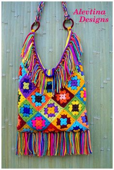 Boho bag, Gypsy bag, Hippie bag, Festival Bag, Ethnic bag, Colorful, Multicolor, Crochet Granny Square, Hippie style, Bohemian Fringe bag, Shoulder bag, pompon hangings Thе item is crocheted in different colors of acrylic yarn and fully lined with sunny-yellow cotton fabric. This bag
