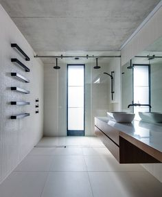 Pale-white micro mosaic tiles + matte black detail elements // Glebe House | Nobbs Radford Architects