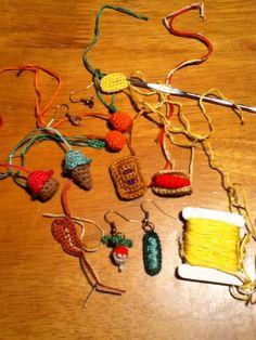 Crochet food earrings using 1.5 mm hook and DMC floss. Radish peas pastry hot dog ice cream cupcake oranges and a steak