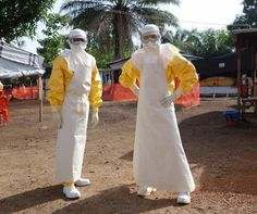 This is a picture of doctors wearing protective clothing in Guinea, western Africa, one of the countries at the center of the Ebola outbreak. Picture Of Doctor, Virus, How To Protect Yourself, Social Events, West Africa, Denial, Doctor Who, Raincoat, How To Wear