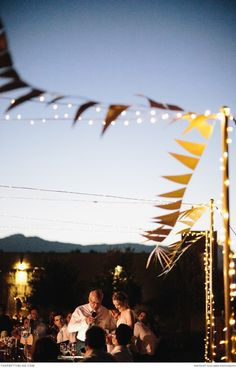 Bunting and fairy lights. Floral & Decor Designer: Studio Bloem