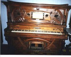 I've always wanted a player piano. My family has one as an heirloom, but I am sure that I'm not on the list to get it.    Art Nouveau player piano