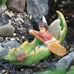 Wee people in the miniature garden are always up for an adventure. Canoeing with Friends is a great way to spend a summer day. Miniature Fairy Figurines, Miniature Fairy Gardens, Clay Fairies, Flower Fairies, Fairy Pots, Winter Greenhouse, Fairy Garden Houses, Fairies Garden, Fairy Crafts