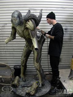 Monster painter Mike Larrabee lays down the base coat on the Predalien suit for AVPR.