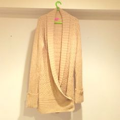 BCBGirls long sweater Tan sweater with cute patterns and button details. Acrylic, wool, & nylon-- very warm! Only worn once!! BCBGirls Sweaters V-Necks