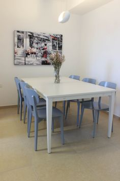white dinning table and blue chairs