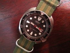 """Seiko 6309-7040 150m diver, January '85.  Roman / English daywheel.  Completely original, totally serviced, running great,  Same watch worn in """"The Abyss"""" by Ed Harris for you underwater SciFi folks.  Also, Mick Jagger wore one for years."""