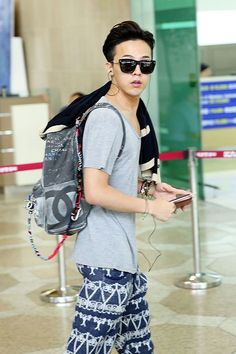 G-Dragon at Incheon Airport on his way to Japan to attend the CHANEL 2013/14…
