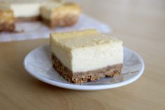 the perfect recipe for vanilla cheesecake bars; thick graham cracker crust; the batter is made with sour cream, extra egg yolks, heavy cream and cornstarch