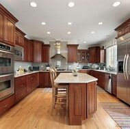 multi-height cherry cabinets with crown and stainless appliances