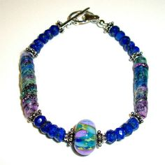 SALE 20 OFF Lapis Bracelet with Lampwork Glass by AndreasJewelry, $50.00