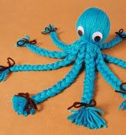 yarn octopus.  My mom made these. My sister\'s was orange. Mine was larger and was purple