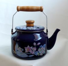 I have this kettle! It was passed down to me from my great great aunt! Vintage Blue Enamelware Sakura Teapot Gailstyn-Sutton by chriscre