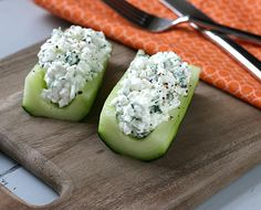 What a yummy and healthy snack! Thick sliced cucumber, layered with cottage cheese mixed with basil and cilantro.