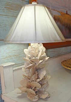 Original earthenware lamp created by Virginia artist Kevin Collins. This life-like coastal designed lamp replicates a cluster of oyster shells attached to a pole with barnacles on shells. Exceptional porcelain earthenware sculpture ready to adorn any coastal home interior.
