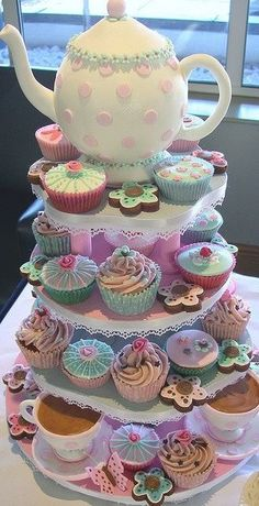 High tea .........with a teapot cake centre piece . Mixing cakes and biscuits and colours......and it looks beautiful.