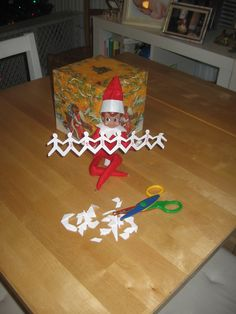 #elf on a shelf paperdoll chain office elf idea, only snowflakes instead