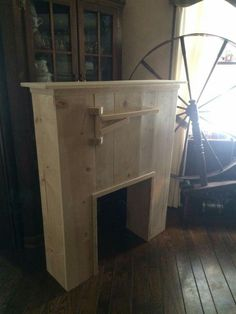 Love it!! Little Prim Fire Place. You can make your own Primitive Fireplace w/ Drying Arm. No instruction, but looks easy t follow....measure your insert for a perfect fit. Paint traditional black or what ever color you choose. Found on fb, Electric heat only.