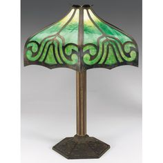 Bradley & Hubbard lamp, bronzed metal base with a daisy pattern, shade with green slag glass