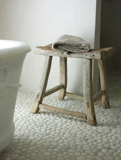 White pebble (river rock) tile (looks great with that weathered wood, by the way)...