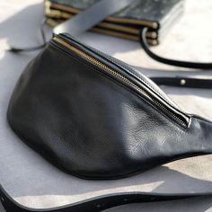 Shop our leather fanny packs. Ensure you handsfree comfort for your on-the-go lifestyle. Made in Europe with vegetable tanned leather. Leather Bum Bags, Leather Fanny Pack, Small Wallet, Zip Around Wallet, Luxury Belts, Waist Pouch, Black Italians, Swag, Large Black
