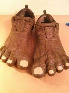 """I attached a pair of """"funny feet"""" men's costume sandles (they look like men's bare feet, size 11) to a pair of slip on shoes.  I used E6000 glue to attach the trimmed foot tops. I then used acrylic paint to paint them, add toenails and added a couple layers of sealer. They really came out very cool, maybe even better than we expected. :)"""